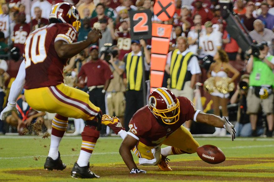 Washington Redskins running back Alfred Morris (46) recovers a fumble by Washington Redskins quarterback Robert Griffin III (10) in the endzone for  a safety in the first quarter as the Washington Redskins play the Philadelphia Eagles in Monday Night NFL football at FedExField, Landover, Md., Monday, September 9, 2013. (Dan Decook / For The Washington Times)