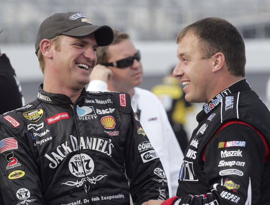 FILE - In this Sept. 14, 2007 file photo, Clint Bowyer, left, smiles with NASCAR driver Ryan Newman after Bowyer won the pole position for the Sylvania 300 NASCAR auto race at New Hampshire International Speedway in Loudon, N.H. His reputation has been battered, his team blasted by NASCAR for manipulating the outcome of a pivotal race. Now Clint Bowyer will do his best to pick up the pieces and try to salvage his season.   (AP Photo/Jim Cole, File)