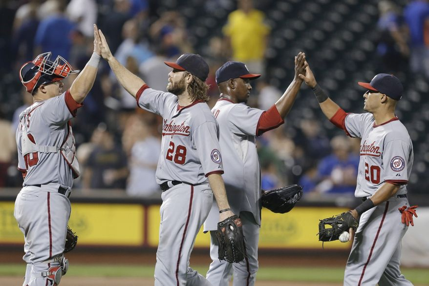 Wilson Ramos, Jayson Werth, Rafael Soriano and Ian Desmond slap hands after sealing a 6-3 victory over the New York Mets on Tuesday night. (Associated Press photo)
