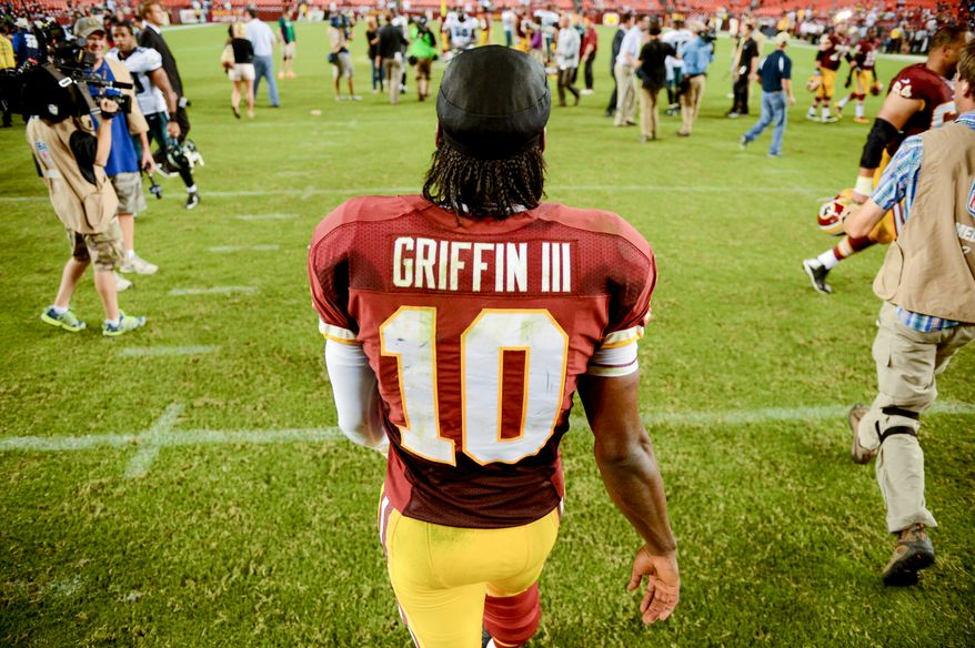 Washington Redskins quarterback Robert Griffin III (10) heads to the locker room after the Washington Redskins lose to the Philadelphia Eagles 33-27 in Monday Night NFL football at FedExField, Landover, Md., Monday, September 9, 2013. (Andrew Harnik/The Washington Times)