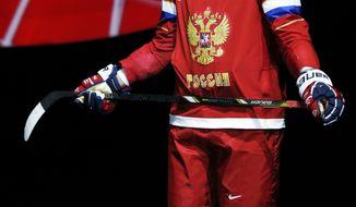 "Russian forward Alexander Ovechkin introduces the new Russian Ice Hockey Olympic team uniform at ""Sokolniki"" Ice Palace in Moscow, Monday, Aug. 26, 2013. (AP Photo/Alexander Zemlianichenko)"