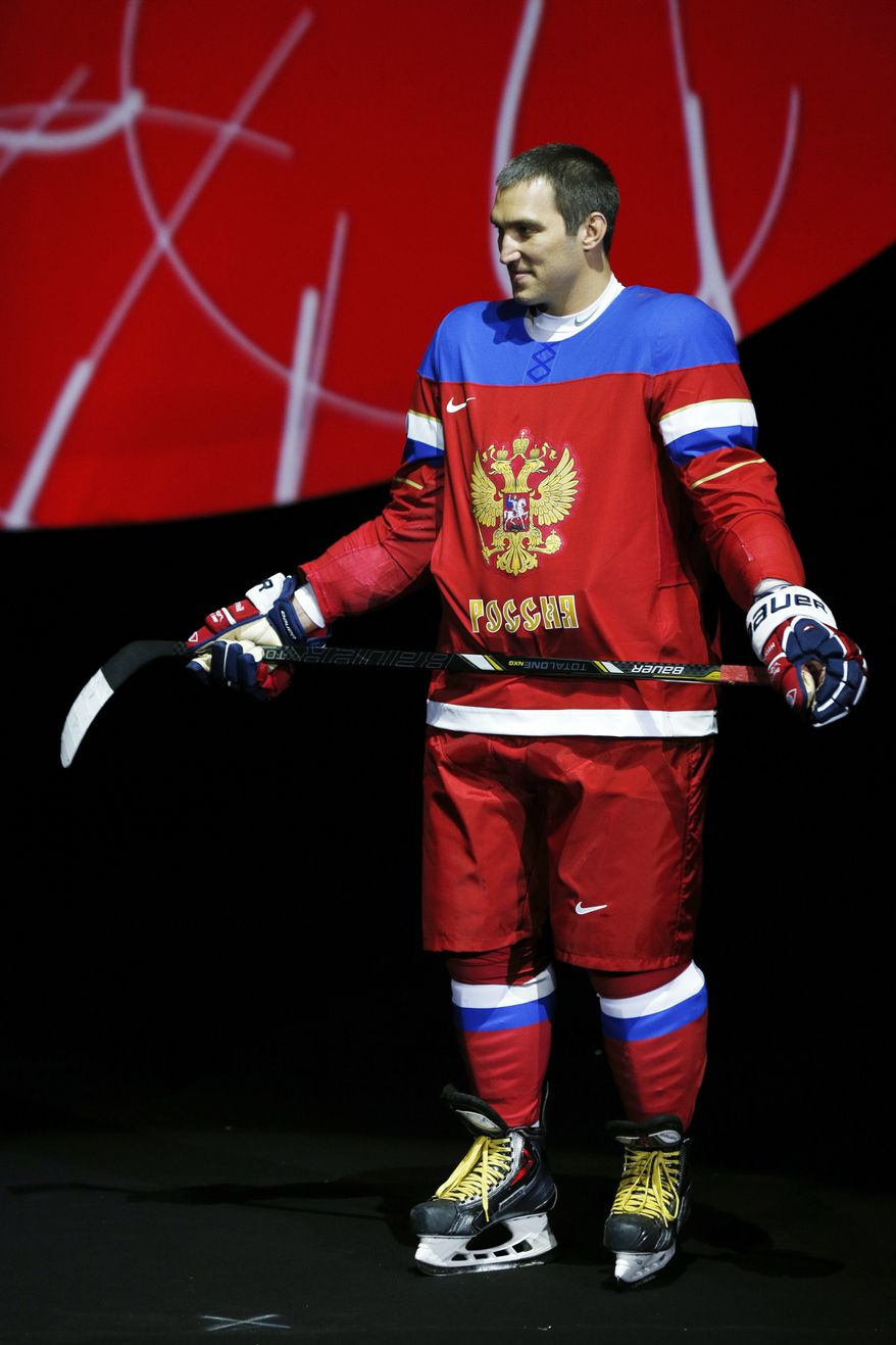 "Russian forward Alexander Ovechkin introduces the new Russian Ice Hockey Olympic team uniform at ""Sokolniki"" Ice Palace in Moscow, Monday, Aug. 26, 2013. (AP Photo/Alexander Zemlianichenko)"