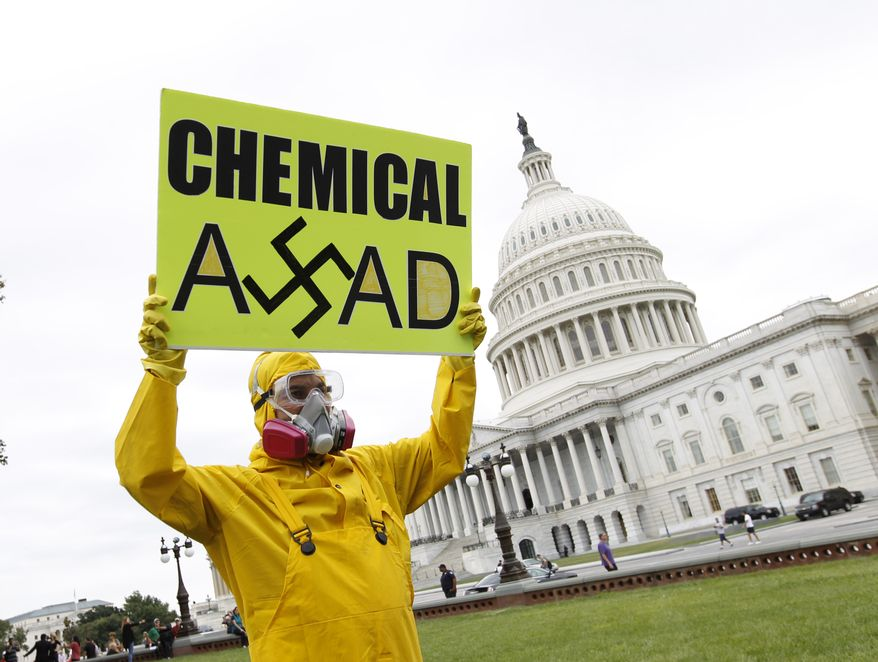 Demonstrators opposed to the government of Syrian President Bashar Assad gather on the lawn of the Capitol in Washington on Sept. 9, 2013, as Congress returns to work from August recess. President Obama is seeking authorization from Congress for a military strike against Syria in response to the use of chemical weapons in the civil war there. (Associated Press)