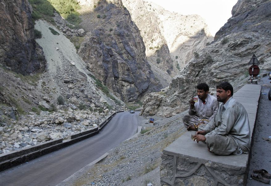 Afghan drivers take a break on the outskirts of Kabul, Afghanistan, Thursday, Sept. 11, 2013. (AP Photo/Ahmad Jamshid)
