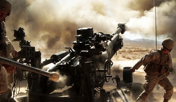 Marines with Battery N, 5th Battalion, 14th Marine Regiment, fire an M777 A2 howitzer during a series of integrated firing exercises at the Marine Corps Air Ground Combat Centter Twentynine Palms' Quakenbush Training Area April 26, 2013. (credit: U.S. Marine Corps)
