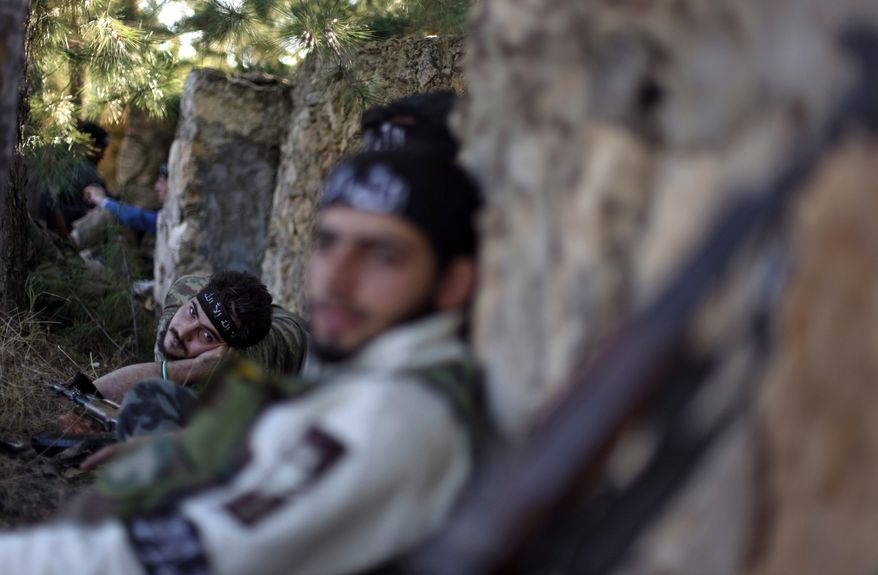 ** FILE ** Syrian rebels rest during clashes with the nation's military troops in Aleppo, Syria, on Nov. 15, 2012. (Associated Press)