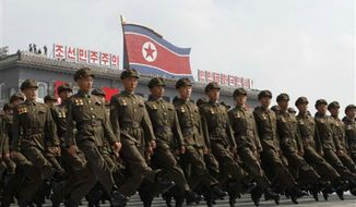 North Korean troops march during a military parade at Kim Il Sung Square to mark the 65th anniversary of the country's founding in Pyongyang, North Korea, Monday, Sept. 9, 2013. (AP Photo/Kim Kwang Hyon)