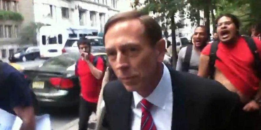 Former CIA Director David H. Petraeus is heckled on the streets of New York while on his way to teach a class at the City University of New York on Monday, Sept. 9, 2013. (YouTube)