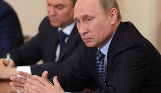 Russian President Vladimir Putin speaks at a meeting with elected regional leaders in the Novo-Ogaryovo residence outside Moscow on Tuesday, Sept. 10, 2013. (AP Photo/RIA-Novosti, Mikhail Klimentyev, Presidential Press Service)