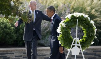 President Obama leaves after laying a wreath at the Pentagon on Wednesday, Sept. 11, 2013, during a ceremony marking the 12th anniversary of the 9/11 attacks. (AP Photo/Manuel Balce Ceneta)