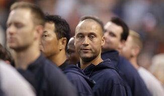 New York Yankees shortstop Derek Jeter, center, stands during the playing of the national anthem before a baseball game against the Baltimore Orioles, Monday, Sept. 9 2013, in Baltimore. (AP Photo/Luis M. Alvarez)
