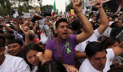 Supporters of former presidential candidate Andres Manuel Lopez Obrador cheer during a protest against the proposed energy reforms that would allow private companies to explore the country's oil and gas reserves. The proposal requires constitutional changes that strike at the heart of one of Mexico's proudest moments: President Lazaro Cardenas' nationalization of the oil company in 1938.