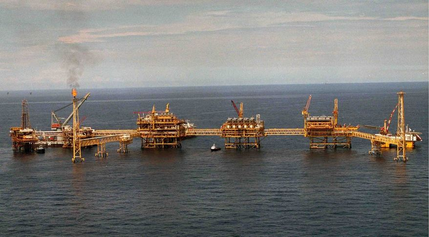 An offshore oil installation is seen in the Gulf of Mexico near the coast of Campeche. The nation's top two presidential candidates are debating whether to turn outward and open oil to private investors, or inward by exporting less crude and giving Mexicans subsidized gasoline. (Associated Press photographs)