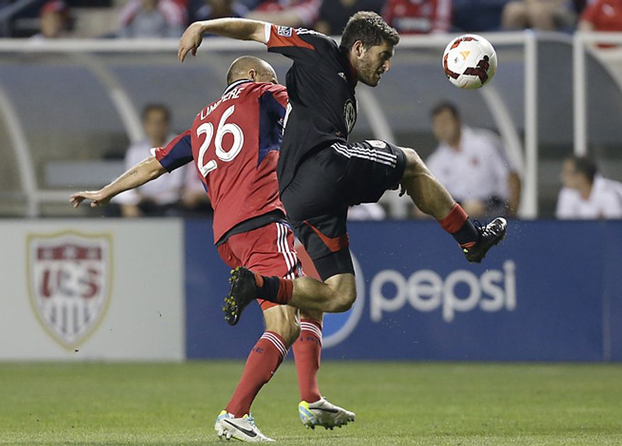 ** FILE ** D.C. United defender Chris Korb, right, controls the ball against Fire midfielder Joel Lindpere. (Associated Press)