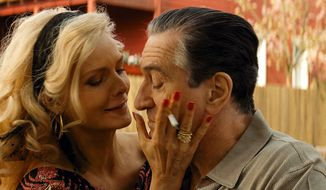 "Michelle Pfeiffer, left, and Robert DeNiro in ""The Family."" (AP Photo/Relativity Media)"