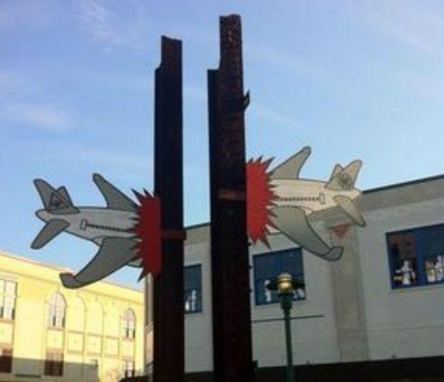 Cardboard cutout 3D graffiti of crashing planes was connected to a 9-11 Memorial in downtown Lafayette, La. (Image: KATC 3 News Lafayette screenshot)