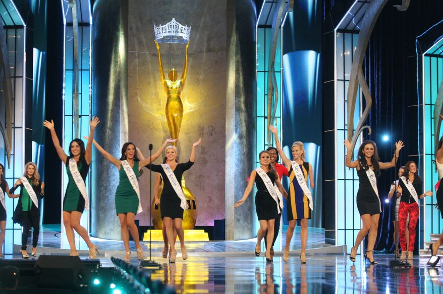 Miss America contestants wave to the audience during the preliminary competition on Wednesday, Sept. 11, 2013, in Atlantic City, N.Y. The program began after a moment of silence for the victims of the Sept. 11, 2001 attacks. (AP Photo/The Press of Atlantic City, Edward Lea)
