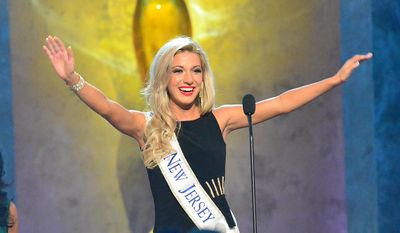 Miss New Jersey, Cara McCollum, waves during the preliminary competition of the Miss America Pageant at Boardwalk Hall on Tuesday Sept. 10, 2013, in Atlantic City, N.J. The preliminary competitions began Tuesday, which is back in Atlantic City after a six-year absence. (AP Photo/The Press of Atlantic City, Ben Fogletto)