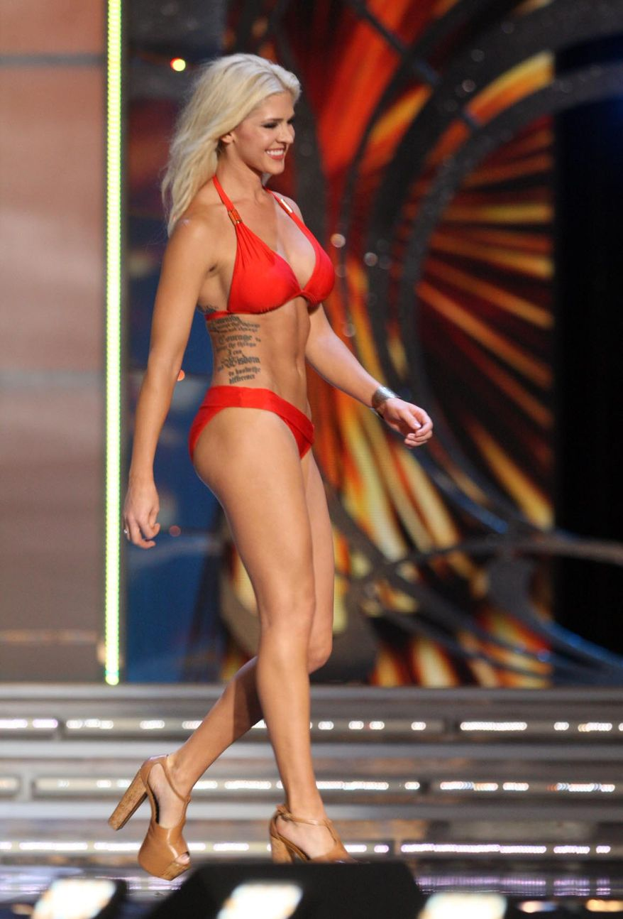 In this Tuesday Sept. 10, 2013 photo, Theresa Vail, Miss Kansas, takes part in the swimsuit competition during the first night of the Miss America Pageant at Boardwalk Hall, in Atlantic City, N.J. Vail isn't looking to shock the nation at the 2014 pageant, but she is trying to empower women to overcome stereotypes and break barriers, she wrote on her blog. Vail, who is competing as Miss Kansas in the 93rd edition of the pageant, announced in the blog post that she will have her two tattoos visibly exposed during the competition. She is believed to be the first contestant in the history of the pageant to do so. (AP Photo/The Press of Atlantic City, Edward Lea)