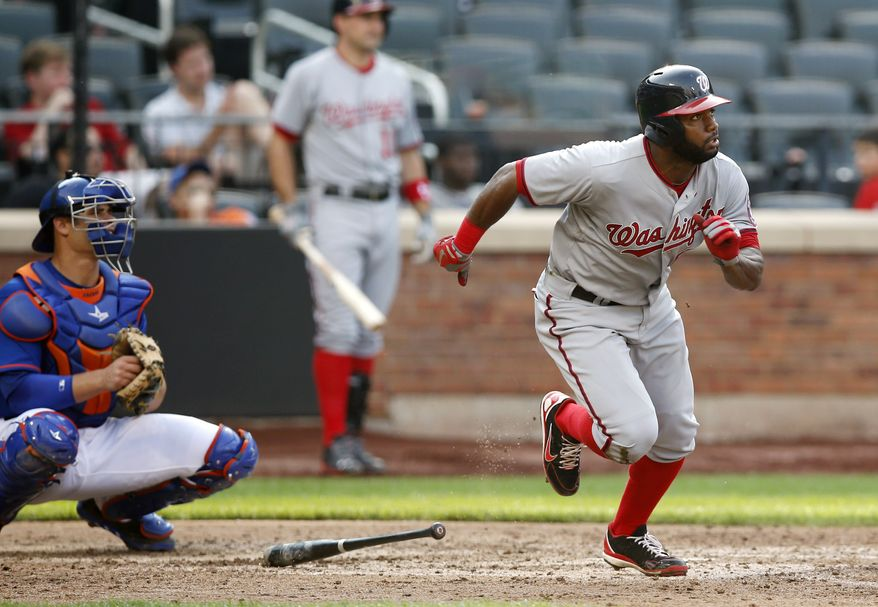 Denard Span watches his eighth-inning double on Thursday that extended his career-long hitting streak to 23 games. (Associated Press photo)