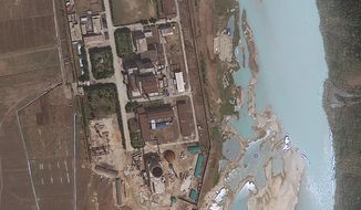 ** FILE ** A satellite image taken on April 30, 2012, shows the area around the Yongbyon nuclear facility in North Korea. (AP Photo/GeoEye)