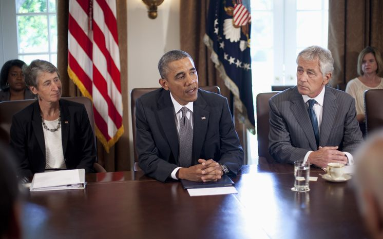 President Obama, flanked by Interior Secretary Sally Jewell (left) and Defense Secretary Chuck Hagel, speaks to members of the press before the start of a cabinet meeting on Sept. 12, 2013, in the Cabinet Room of the White House. (Associated Press)