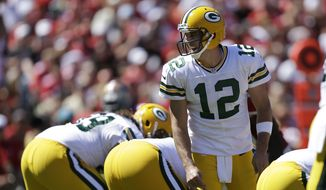 Green Bay Packers quarterback Aaron Rodgers (12) is seen reacting against the San Francisco 49ers during the first half of an NFL football game in San Francisco, Sunday, Sept. 8, 2013. (AP Photo/Ben Margot)