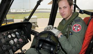 ** FILE ** In this Friday, June 1, 2012, file photo released by Britain's Ministry of Defence, Britain's Prince William sits in the cockpit of a helicopter at RAF Valley in Anglesey Wales. Prince William has finished his tour of duty as a Royal Air Force search-and-rescue helicopter pilot and has left operational service with the British military to focus on royal duties and charity work, royal officials said Thursday, Sept 12, 2013. (AP Photo/ SAC Faye Storer, MOD, File)