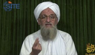 "** FILE ** This file image from video the AP obtained Feb. 12, 2012, from the SITE Intel Group, an American private terrorist threat analysis company, shows al Qaeda's leader Ayman al-Zawahri in a web posting by al Qaeda's media arm, as-Sahab, calling on Muslims across the Arab world and beyond to support rebels in Syria who are seeking to overthrow President Bashar Assad. Al-Zawahri marked the 12th anniversary of the Sept. 11, 2001, attacks by calling on Muslims to strike inside the United States, using any opportunity they can to ""bleed"" America financially, speaking in an audio message released Thursday, Sept. 12, 2013. (AP Photo/SITE Intel Group, File)"