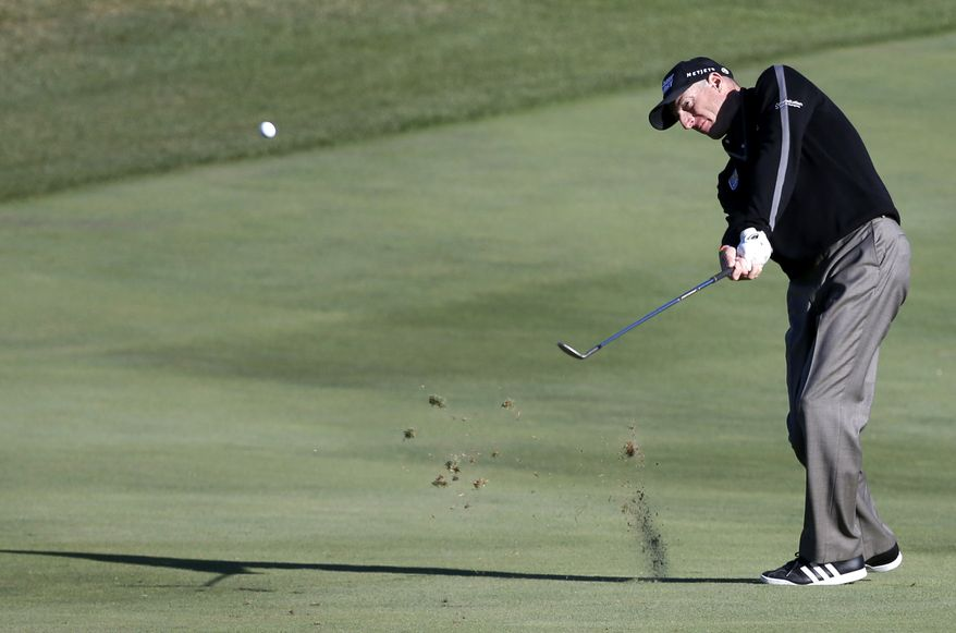 Jim Furyk hits his approach shot on the ninth fairway during the second round of the BMW Championship golf tournament at Conway Farms Golf Club in Lake Forest, Ill., on Sept. 13, 2013. Furyk posted a single-round 59, becoming the sixth player to reach that milestone. (Associated Press)