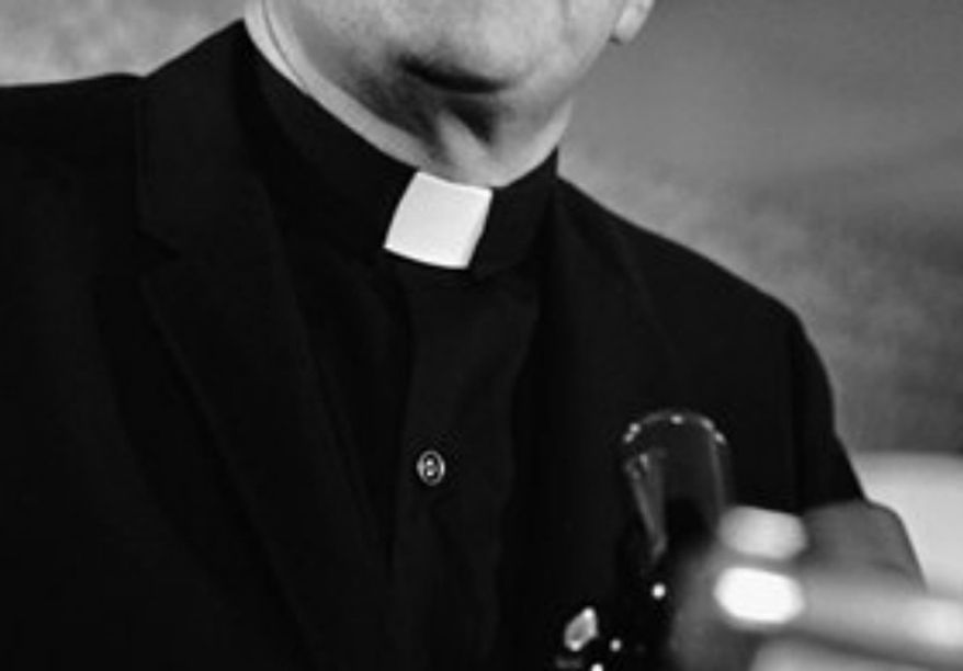 ** FILE ** Catholic priest (Associated Press)