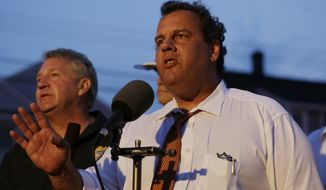 New Jersey Gov. Chris Christie addresses the media near the area hit by a massive fire on Thursday, Sept. 12, 2013, in Seaside Park, N.J. The fire began in a frozen custard stand on the Seaside Park section of the boardwalk and quickly spread north into neighboring Seaside Heights. (AP Photo/Julio Cortez)