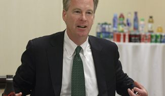 ** FILE ** In this June 7, 2012, file photo, Steve Cahillane, president of Coca-Cola Americas, makes a point during an interview with The Associated Press while attending the Clinton Global Initiative America gathering in Chicago. Cahillane is scheduled to be at at the Midewin National Tallgrass Prairie in Wilmington, Ill., on Friday, Sept. 13, 2013, to sign a five-year partnership with U.S. Agriculture Secretary Tom Vilsack to restore watersheds that have been damaged or altered by development, wildfires and agriculture. (AP Photo/M. Spencer Green, File)