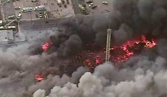 This image from aerial video shows a raging fire in Seaside Park, N.J., on Thursday, Sept. 12, 2013. The fire began in a frozen custard stand on the Seaside Park section of the boardwalk and quickly spread north into neighboring Seaside Heights. (AP Photo/ABC)