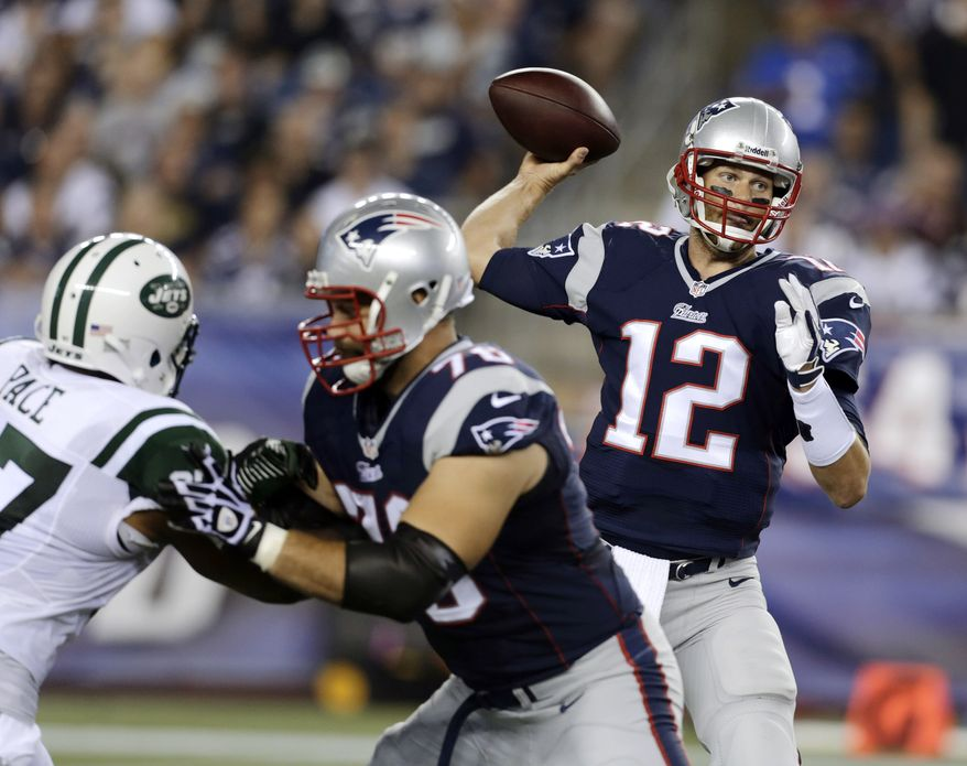 New England Patriots quarterback Tom Brady (12) passes against the New York Jets in the first quarter of an NFL football game Thursday, Sept. 12, 2013, in Foxborough, Mass. (AP Photo/Charles Krupa)
