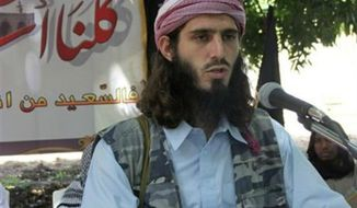 ** FILE ** American-born Islamist militant Omar Hammami addresses a press conference of the militant group al-Shabab at a farm in southern Mogadishu's Afgoye district in Somalia, May 11, 2011. (AP Photo/Farah Abdi Warsameh, File)