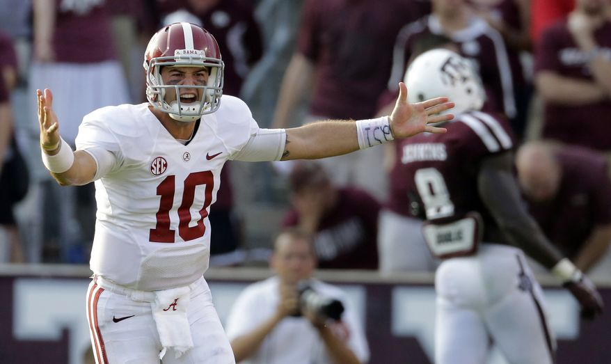 Alabama quarterback AJ McCarron (10) celebrates after throwing a touchdown pass to Jalston Fowler during the fourth quarter of an NCAA college football game against Texas A&M Saturday, Sept. 14, 2013, in College Station, Texas. Alabama won 49-42. (AP Photo/David J. Phillip)