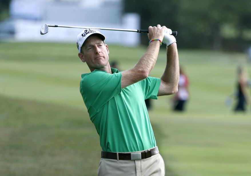 Jim Furyk watches his approach shot to the 18th green during the third round of the BMW Championship golf tournament at Conway Farms Golf Club in Lake Forest, Ill., Saturday, Sept. 14, 2013. (AP Photo/Charles Rex Arbogast)