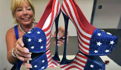 "Miss America volunteer Fran McManus, looks at the shoes Miss Pennsylvania Annie Rosellini's will wear in the 2014 Miss America pageant's ""show us your shoes"" parade, at Boardwalk Hall, on Tuesday, Sept. 10, 2013, in Atlantic City, N.J. (AP Photo/The Press of Atlantic City, Michael Ein)"