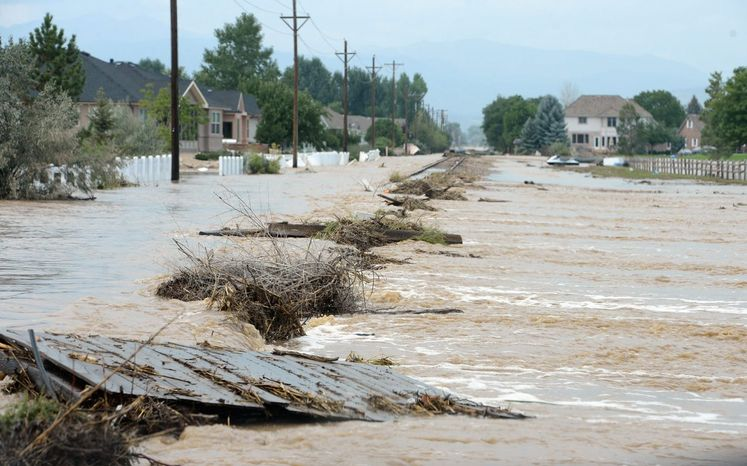 Railroad tracks were flooded in Longmont, Colo., during the weekend. The Colorado Transportation Department reported that 30 bridges have been destroyed and damage has not been assessed on several roads. (Associated Press Photographs)