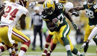 Green Bay Packers' Eddie Lacy runs during the first half of an NFL football game against the Washington Redskins Sunday, Sept. 15, 2013, in Green Bay, Wis. (AP Photo/Tom Lynn)