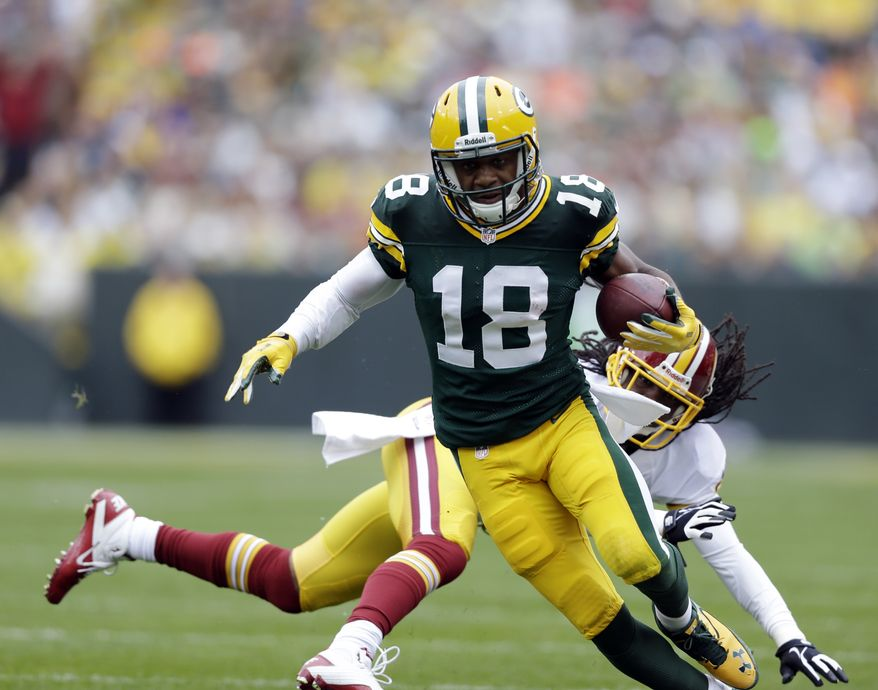 Green Bay Packers' Randall Cobb (18) gets past Washington Redskins' Brandon Meriweather after a catch during the first half of an NFL football game Sunday, Sept. 15, 2013, in Green Bay, Wis. (AP Photo/Tom Lynn)
