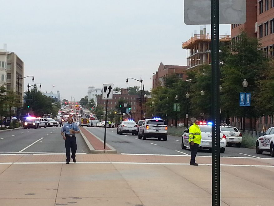 Police respond to an active shooter on the loose at the Washington Navy Yard on Monday, Sept. 16. (Washington Times/Drew Geraci)