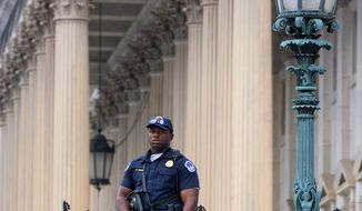 U.S. Capitol Police keep watch on the East Front of the Capitol after the shooting at the Washington Navy Yard on Monday. (Associated Press)