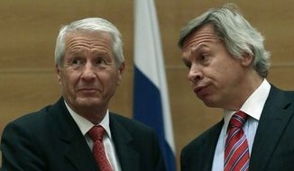 **FILE** Thorbjoern Jagland, secretary general of the Council of Europe (left) speaks to Chairman of the Russian parliamentary committee on international affairs Alexey Pushkov during his meeting with lawmakers at the State Duma, lower parliament chamber, in Moscow on May 21, 2013. (Associated Press)