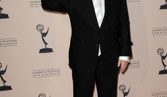 """Bob Newhart poses backstage with his award for outstanding guest actor in a comedy series for """"The Big Bang Theory"""" at the Primetime Creative Arts Emmy Awards at the Nokia Theatre L.A. Live on Sunday, Sept. 15, 2013, in Los Angeles. (Photo by Richard Shotwell/Invision/AP)"""