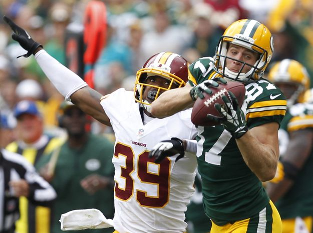Green Bay Packers' Jordy Nelson (87) catches a pass in front of Washington Redskins' David Amerson (39) during the second half of an NFL football game Sunday, Sept. 15, 2013, in Green Bay, Wis. (AP Photo/Mike Roemer)