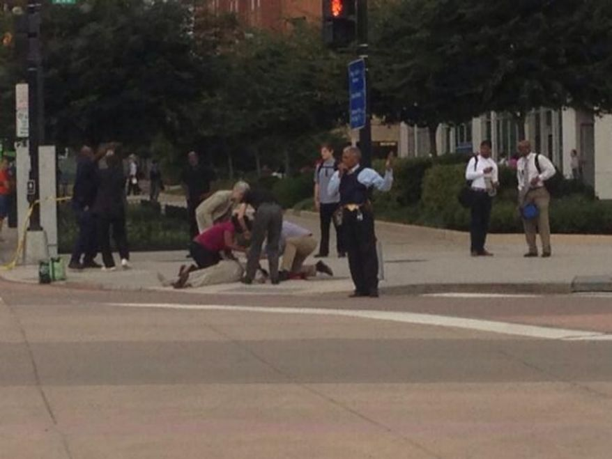 A man is down outside the Washington Navy Yard. (credit: timjhogan/twitter)