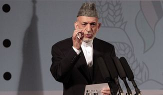 Afghan President Hamid Karzai, speaking at a youth conference in Kabul, Afghanistan, on Tuesday, Sept. 17, 2013, said he was in no rush to sign a security deal with the United States, once again dashing American hopes that a pact can be finalized quickly. (AP Photo/Rahmat Gul)