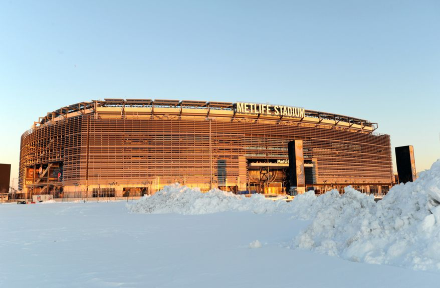 **FILE** In this Feb. 9, 2013, file photo, snow is piled high in a parking lot outside of MetLife Stadium in East Rutherford, N.J., site of this season's Super Bowl  (AP Photo/Bill Kostroun, File)